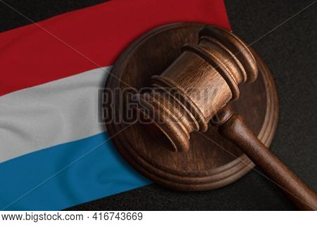 Judge Gavel And Flag Of Luxembourg. Law And Justice In Luxembourg. Violation Of Rights And Freedoms.
