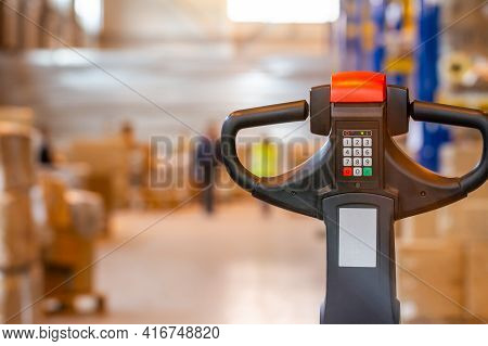 Electric Forklift Pallet Jack Controller Close Up View In A Modern Warehouse Storage. Warehouse Inve