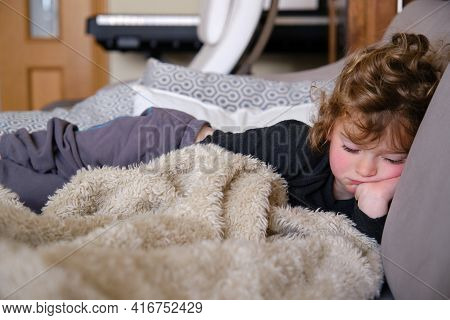 Sleepy Toddler Child Napping In The Afternoon On A Sofa