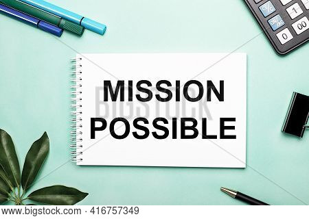 Mission Possible Is Written On A White Sheet On A Blue Background Near The Stationery And The Scheff