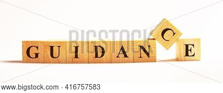 On A Light Background, Wooden Cubes With The Text Guidance