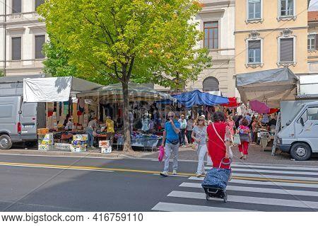 Como, Italy - June 15, 2019: Shoppers At Open Street Market Saturday In Como, Italy.