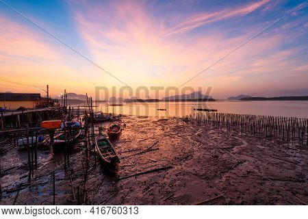 Beautiful Sky In The Morning During Sunrise And Fisherman Longtail Boats