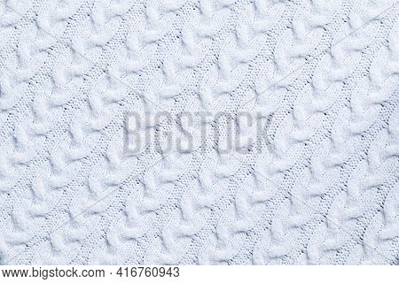 We Knit The Texture Of A White Woolen Knitted Fabric With A Pattern. Knitting. Knitting Pattern. Pla