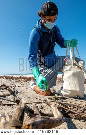 Volunteer Keeping Plastic Waste Out From Furadouro Beach In Ovar, Portugal