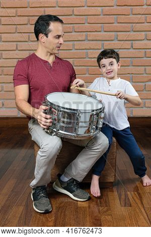 Father (44 Years Old) Teaching His Son (7 Years Old) The First Drum Lessons, Photo 2. Brick Wall Bac
