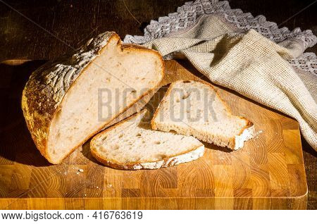 Still Life - Yeast-free Buckwheat Bread With Sliced Pieces, And A Linen Napkin On A Wooden Board, A