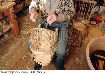 A Basket Maker Weaves A Basket