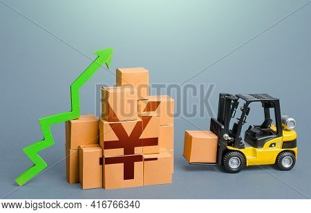 Forklift And Stack Of Boxes With Yen Or Yuan Symbol And Green Up Arrow. Sales Growth Concept. Increa