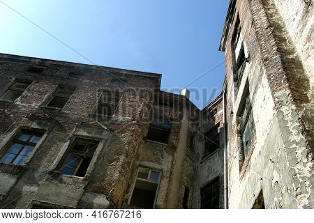 A Photo Of The Architecture Showing The Damaged Facade Of The Tenement House Intended For Demolition
