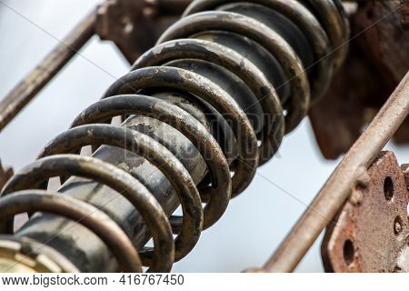 Old Motorcycle Spring Suspension, Close-up, Visible Rust And Erosion Of Metal