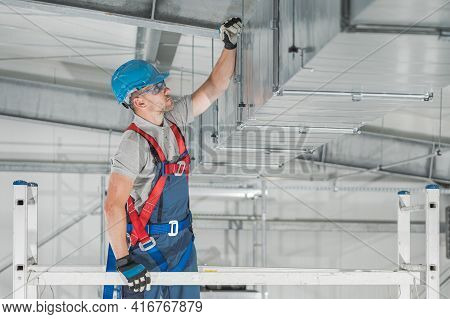Commercial Hvac Systems Installation Inside The Warehouse Performed By Caucasian Heating And Cooling