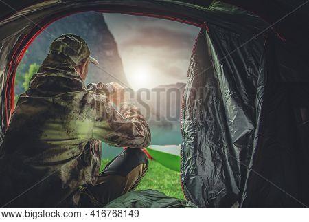 Caucasian Hunter In His 40s Spotting Wildlife Using Professional Binoculars Straight From His Huntin