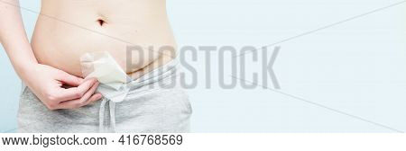 Closeup Of Woman Belly With Scar From Cesarean Section With A Medical Bandage. Suture After Surgery.