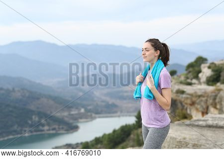 Happy Runner Grabbing Towel Contemplating Views After Sport In The Mountain