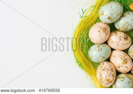 Colorful Easter Eggs In Basket Isolated On White Background And Copy Space On Left Side