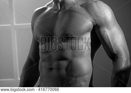 Healthy Mature Man Standing Strong, Flexing Muscles - Muscular Athletic Bodybuilder Fitness Male.