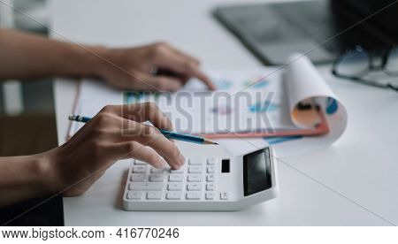 Close Up Businessman Using Calculator For Analysis Maketing Plan, Accountant Calculate Financial Rep