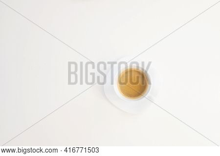 Close up top view of a white cup of coffee shoot from above isolated on white background with copy space