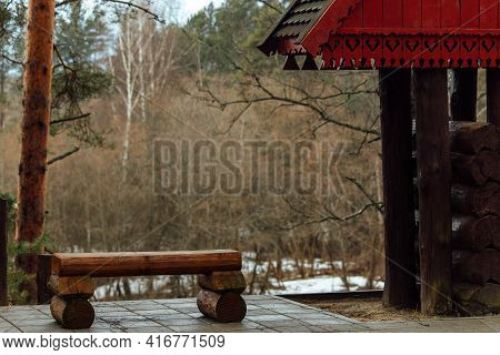 Wooden Bench On The River Bank. A Quiet Secluded Place In A Deserted Park In The Bosom Of Nature. A