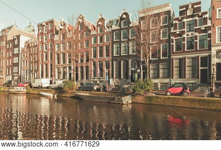 Amsterdam, Netherlands - February 24, 2017: Street View Of Amsterdam Old Town With People Walking Th