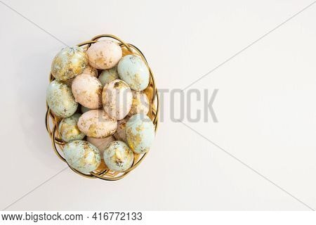 Colorful Easter Eggs In Basket Isolated On White Background And Copy Space On Right Side