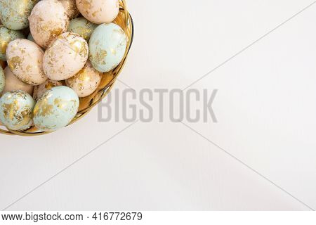 Colorful Easter Eggs In Basket Isolated On White Background And Copy Space On Right Bottom
