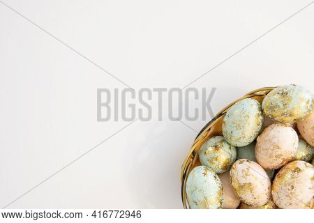 Colorful Easter Eggs In Basket Isolated On White Background And Copy Space On Left Top Corner