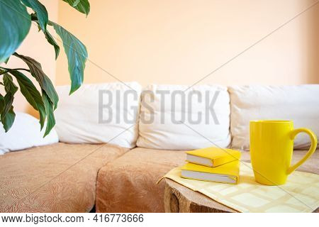 Comfortable Light Recreation Area For Relaxation With Couch, House Plants, Yellow Cup And Notepads C