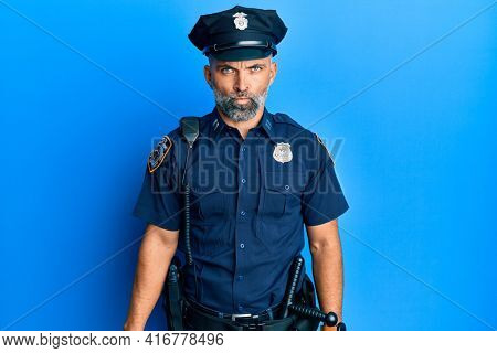 Middle age handsome man wearing police uniform skeptic and nervous, frowning upset because of problem. negative person.