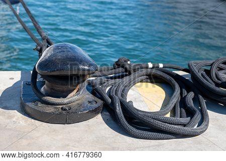 Boat Ropes On Black Mooring Bollard, Luxury Yachts Marina Pier