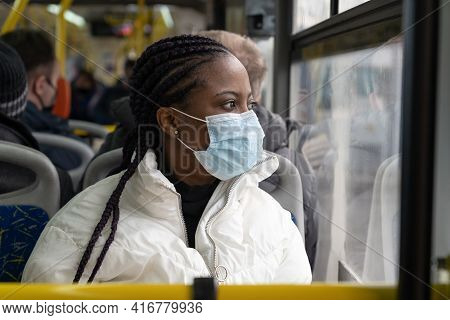 African American Woman Wear Medical Mask While Travel In Public Transport, Bus Shuttle In New Normal