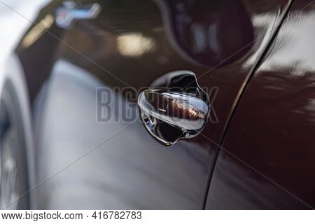Car Door Handle With Keyless Enrty System. The Car Body Is Dark In Color. Black Car Body. Driver's D