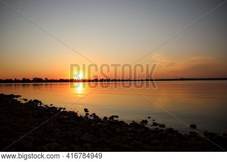 Picturesque View Of Rocky Beach At Sunset