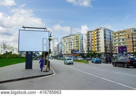 Tangier, Morocco - 18 October, 2019: Mockup Of Blank White Billboard On Urban Street. Outdoor Billbo