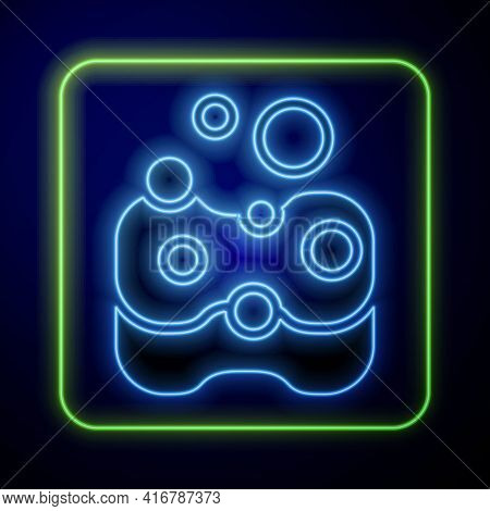 Glowing Neon Sponge Icon Isolated On Blue Background. Wisp Of Bast For Washing Dishes. Cleaning Serv