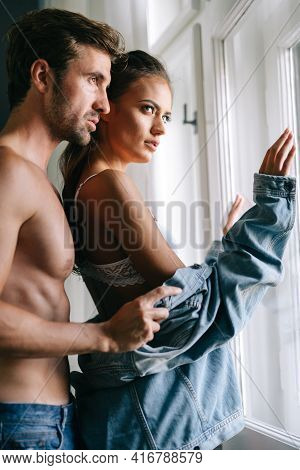 Sensual Foreplay By Couple In Bedroom. Passion, Desire, Romance Concept.
