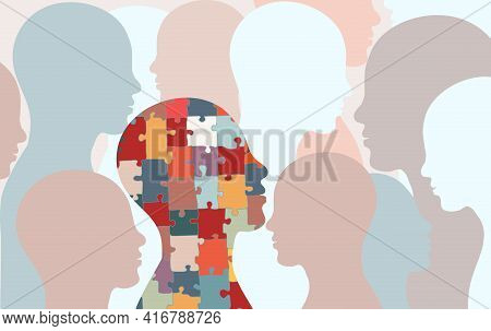 Autism Syndrome Concept. Jigsaw That Forms Human Head In Profile With Other People's Background. Lea