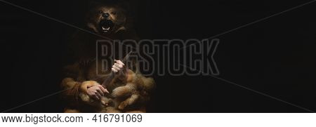 Panoramic Low Key Portrait Of A Bearded War Shaman In Bearskin With An Ancient Ax In His Hands. High