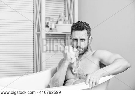 Hygiene And Health. Sexuality And Relaxation. Personal Care. Sexy Man In Bathroom. Desire And Tempta