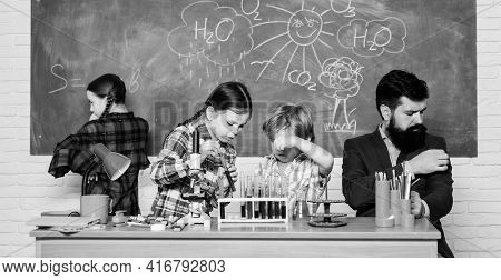 Fascinating Chemistry Lesson. Man Bearded Teacher And Pupils With Test Tubes In Classroom. School Ch
