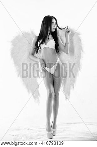 Playful And Full Sexual Desire. Attractive Sensual Woman With Angel Wings And High Heels. Innocent A