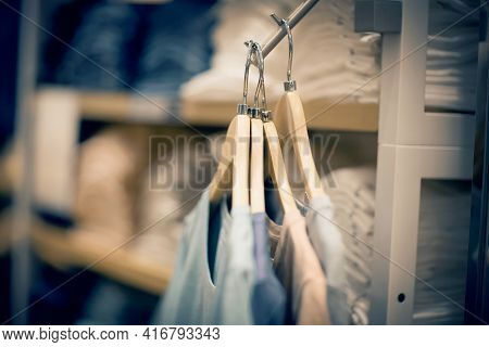 T-shirts On Hangers. Stacks Of Clothes. Shopping In Store. Clothes On Hangers In Shop For Sale. Blur