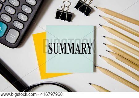 Summary Text Written On A White Notepad With Colored Pencils And A Yellow Background. Word