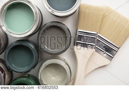 Overhead View Of A Diy Paint Brush With Trendy Green Sample Paint Pots