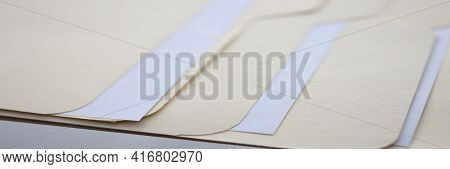 Beige Folders With Documents Are On Table