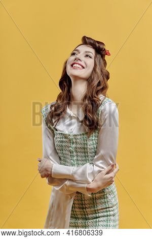 Portrait Of A Happy Young Beautiful Brunette Woman With Wavy Hair. Pin-up Style