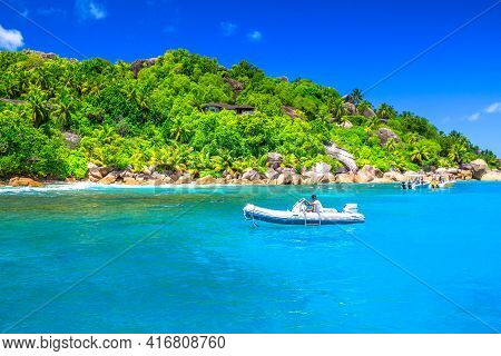 Felicite Island, Seychelles - May 3, 2019: Sailboat, Motorboat And Snorkelers At Felicite Island Mar