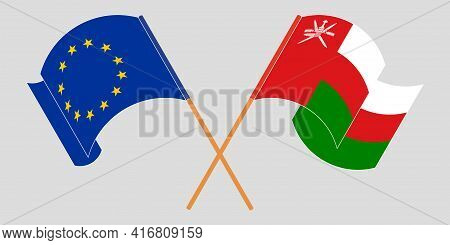 Crossed And Waving Flags Of Oman And The Eu