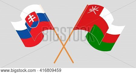 Crossed And Waving Flags Of Oman And Slovakia